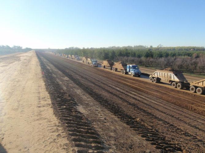 trucks hauling dirt