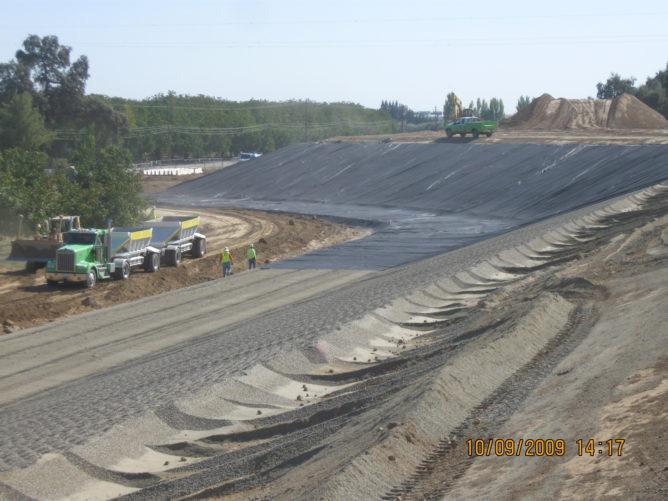 trucks around a tall hill of dirt