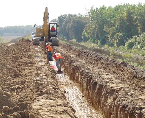 construction crane plowing through mud