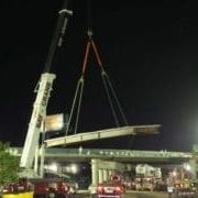 construction crane holding cement block