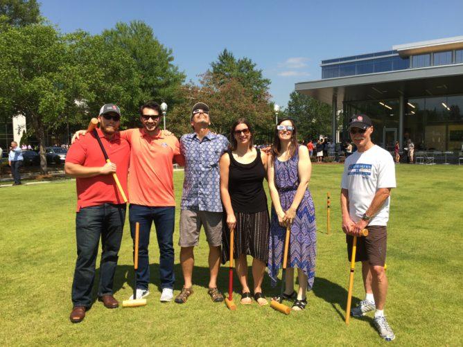 GEI employees with croquet sticks