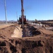 construction crane in dirt
