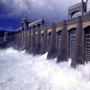 water streaming through dam wall