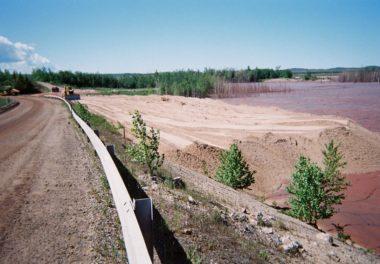 construction trucks flattening out dirt