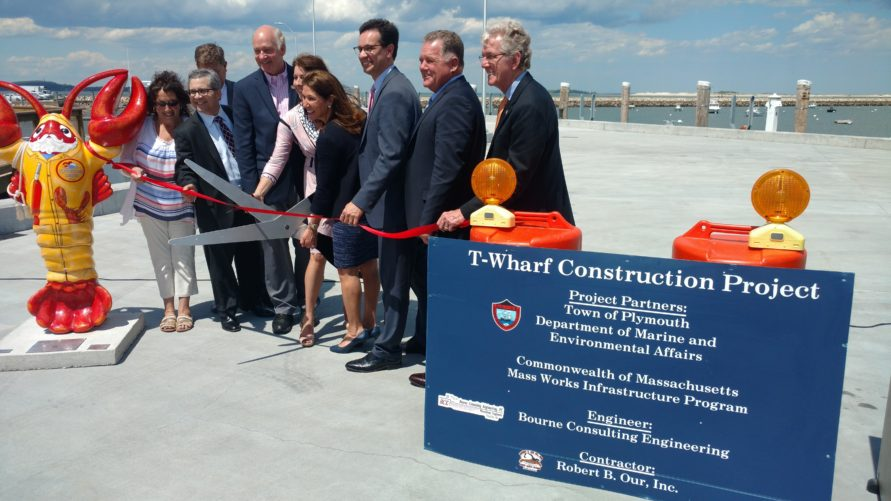 people cutting ribbon at T Wharf commercial pier