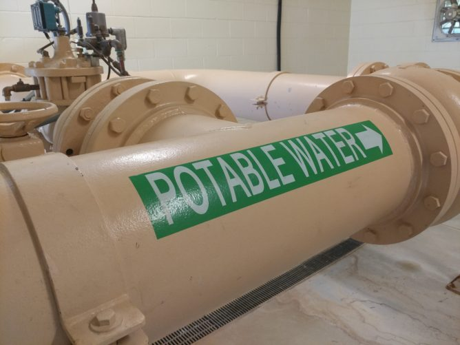 pipe with Potable Water label