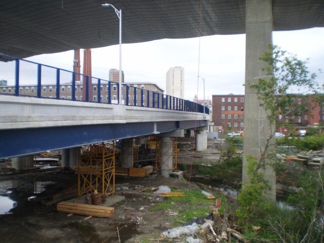 small bridge under larger interstate bridge