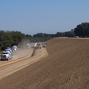 trucks driving on dirt at levee