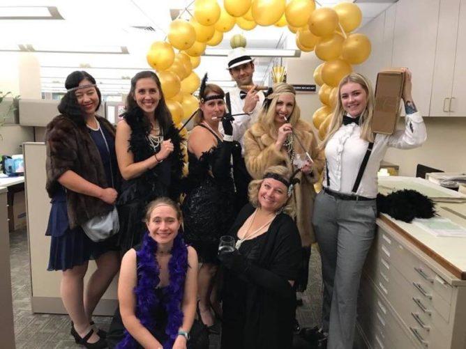 GEI Consultants employees in various Halloween costumes