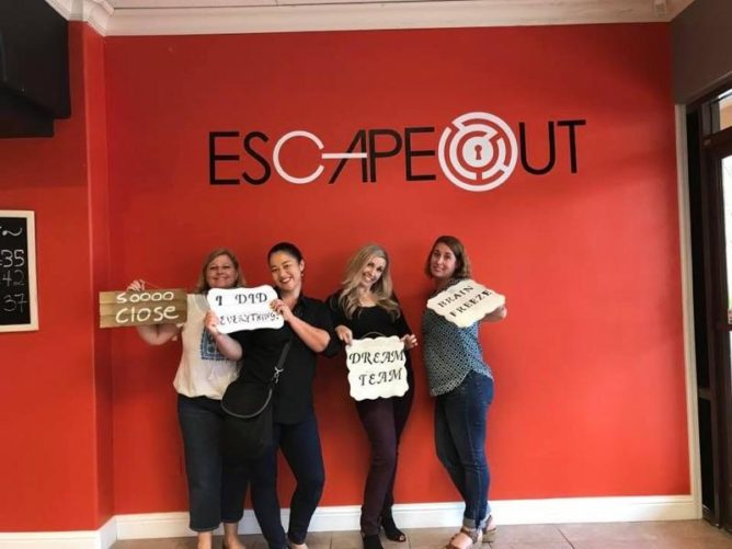 GEI Consultants employees at the end of Escape Out room