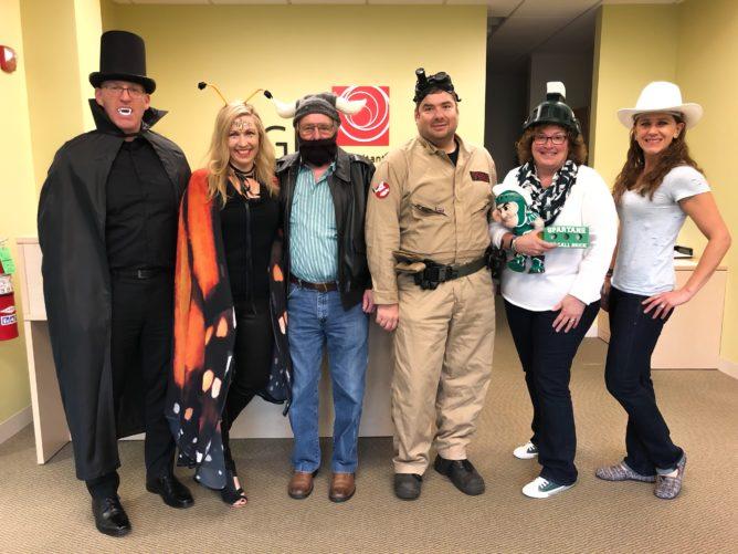 GEI team in various Halloween costumes