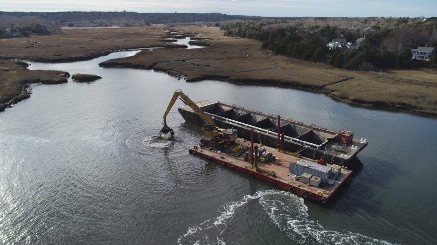 overhead view of construction crane doing dredging work in Sesuit Harbour