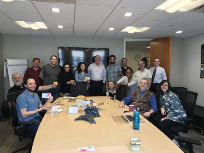 GEI team around table with pies