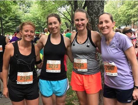 4 women wearing race bibs
