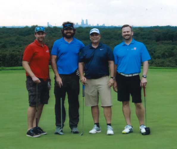 4 men on a golf course